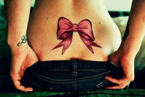 Bow Lower Back Tattoo