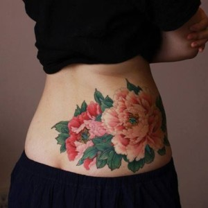 Gorgeous Flowers Lower Back Tattoo