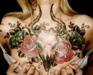 Horn And Roses Chest Tattoo