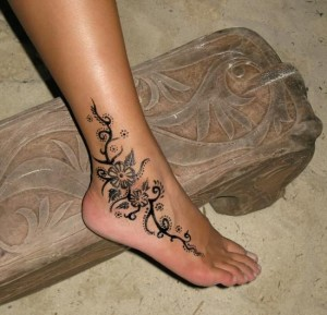 Intricate Tribal Floral Ankle Tattoo
