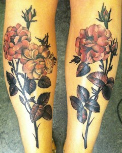 Red Flowers Back Of The Legs Tattoos