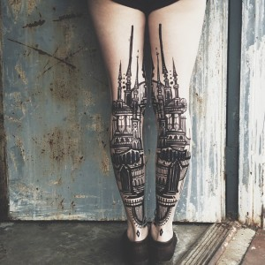 Towering Structures Back Of The Leg Tattoo