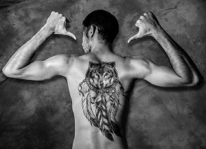 Indian Style Wolf Back Tattoo
