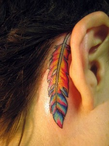 Lovely Feather Under The Ear Tattoo