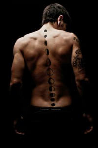 Moon Phases Spine Tattoo