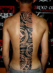 Negative Space Tribal Spine Tattoo