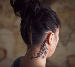 Traditional Feather Behind The Ear Tattoo