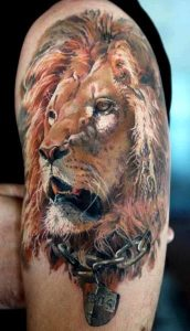 Chained Lion Arm Tattoo