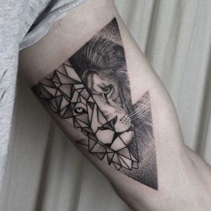 Contemporary Style Lion Arm Tattoo