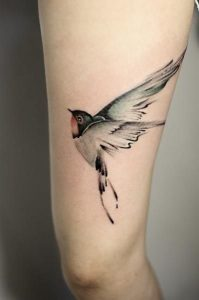 Fearless Swallow Thigh Tattoo