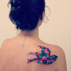 Floral Swallow Back Tattoo