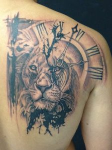 Lion And Clock Back Tattoo