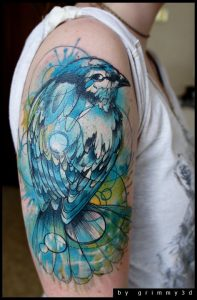 Lovely Colored Swallow Arm Tattoo