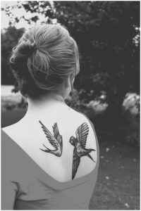 Lovely Swallow Couple Back Tattoo