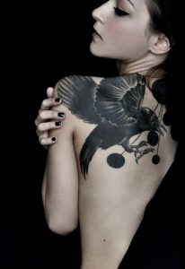 Raven And Dots Back Tattoo