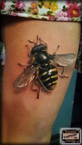 Realistic Bee Thigh Tattoo