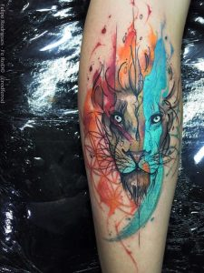 Sketchy And Vibrant Lion Leg Tattoo