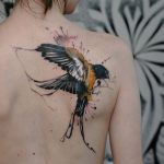 Stunning Watercolor Swallow Back Tattoo
