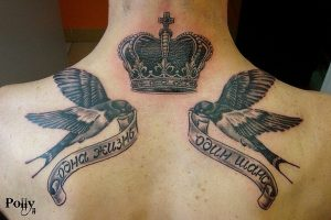 Swallow And Crown Back Tattoo