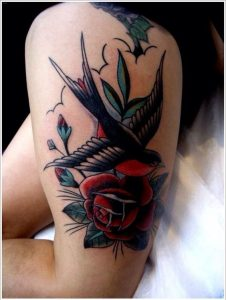 Swallow In A Field Of Roses Thigh Tattoo