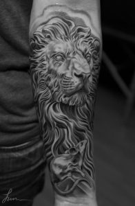 The Lion And The Mouse Forearm Tattoo