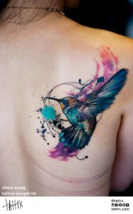 Watercolor Swallow Back Tattoo