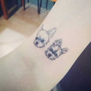 Charming Pooches Arm Tattoo