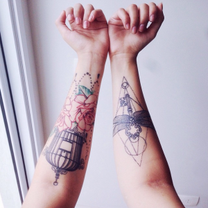 Geometric Bewitched Key Forearm Tattoo
