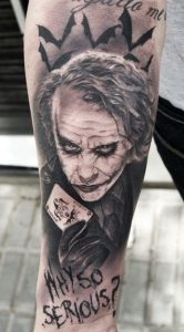 Joker And His Card Forearm Tattoo