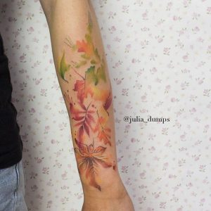 Lovely Pastel Colored Leaves Arm Tattoo