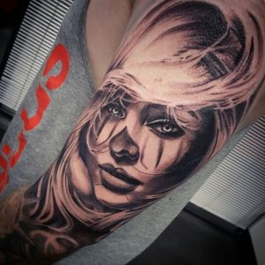 Sophisticated Clown Arm Tattoo