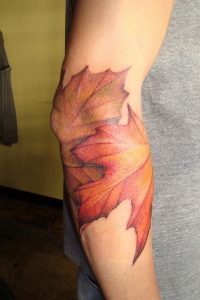 Wrapped Maple Leaves Arm Tattoo