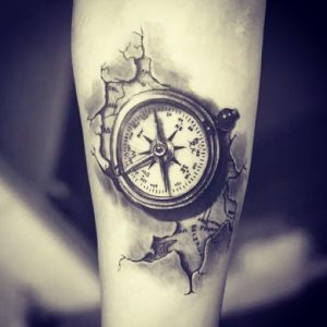 Compass On Torned Surface Tattoo
