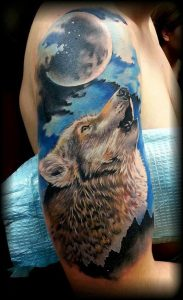 Detailed Howling Wolf Arm Tattoo