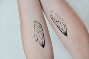 Insect Wings Forearm Tattoo