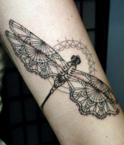 Laced Dragonfly Arm Tattoo