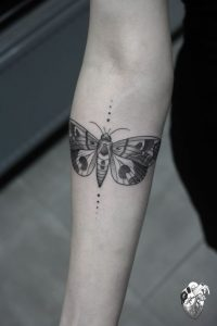 Moth And Dots Forearm Tattoo