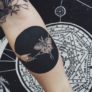 Negative Space Butterfly Forearm Tattoo