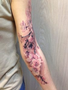 Orchid Bouquet Arm Tattoo