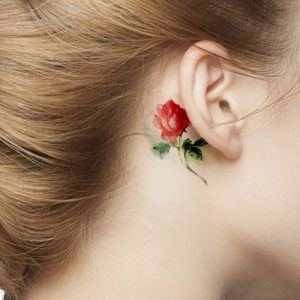 Subtle Watercolor Rose Behind The Ear Tattoo