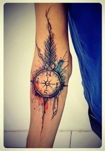 Watercolor Feathered Compass Forearm Tattoo