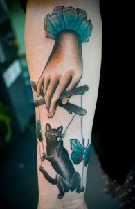 Cat Puppet Forearm Tattoo