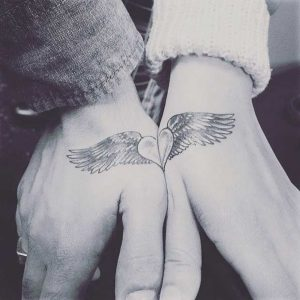 Connecting Winged Heart Hand Tattoos