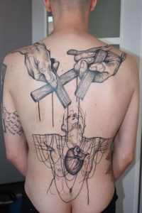 Intricate Sketchy Puppet Back Tattoo