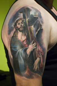 Jesus Carrying The Cross Arm Tattoo