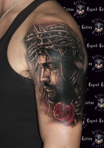 Jesus With Rose And Thorn Arm Tattoo
