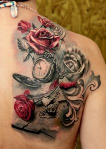 Music Sheets, Roses And Pocket Watch Back Tattoo