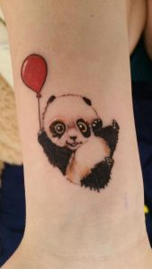 Panda With Red Balloon Arm Tattoo
