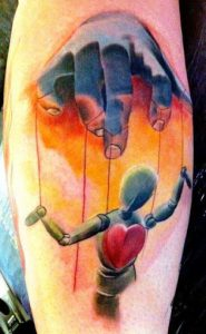 Watercolor Realism Puppet Tattoo