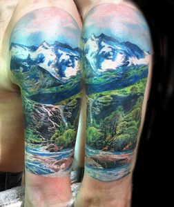 Amazing Mountain Range And River View Arm Tattoo